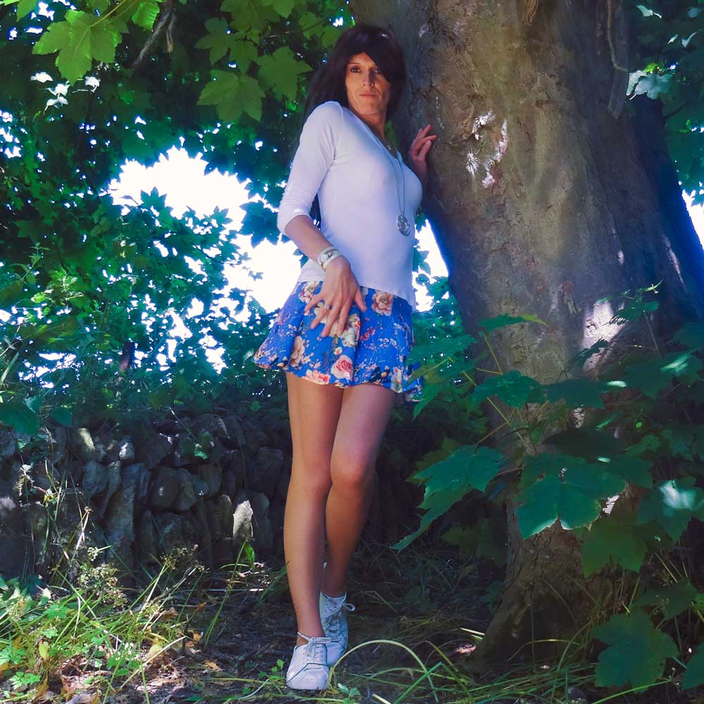 Glamorous Scuba Mini Skirt in Floral Print with White Top Modelling Photo, by Transgender Model SOPHiE LAWSON